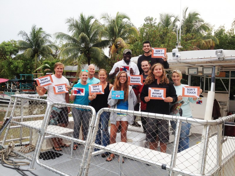 Shortly after completing their Blue Star training, Looe Key Reef Resort Staff proudly display their new Blue Star decal, along with reminders of reef etiquette for divers and snorkelers.
