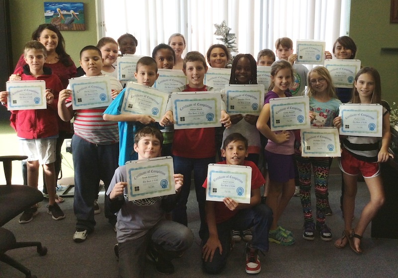 Mrs. Albury's 5th grade class proudly displaying their coding certification.