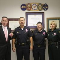 Law Enforcement Members Show Pink Badges in Recognition of Breast Cancer Awareness Month