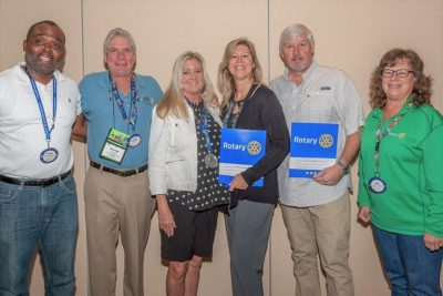 Key West Sunrise Rotary Installs Law Enforcement Couple as New Members