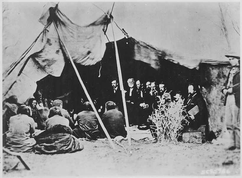 Photograph of General William T. Sherman and Commissioners in Council with Indian Chiefs at Fort Laramie, Wyoming, ca. 1868 (Photo credit: Wikipedia)