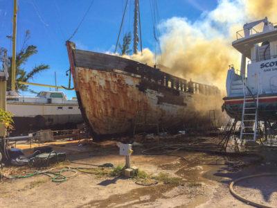 Fire on Abandoned Trawler at Robbie's Marina Stock Island