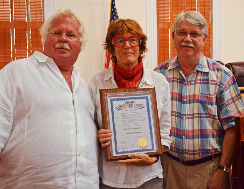 Mayor pro tem Mark Rossi and Commissioner Jimmy Weekley with Key West Poet Laureate Rosaline Brackenbury.