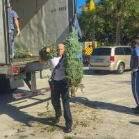 Monroe County Fire Rescue Unload Christmas Trees for Church
