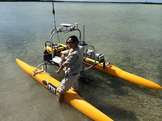 Unmanned surface vessel (USV) in Cudjoe Key deploying a submersible fluorometer to measure dye concentration
