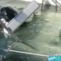 Woman Raises Sunken Boat With a Bucket